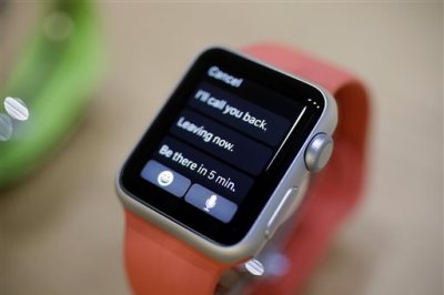 A variety of the new Apple Watch is on display in the demo room after an Apple event on Monday, March 9, 2015, in San Francisco. Pre-orders for the Apple Watch start April 10. The device costs $349 for a base model, while a luxury gold version will go for $10,000. (AP Photo/Eric Risberg)