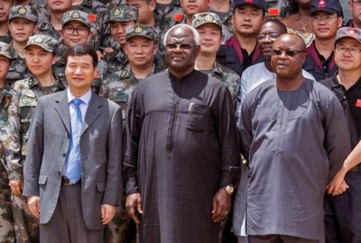 "In this file photo taken on Sept. 25, 2015, Chinese Ambassador Zhao Yanbo, left, stand next to Sierra Leone's president Ernest Bai Koroma, center, and  Sierra Leone's  Vice President Samuel Sam-Sumana,  right, during the opening ceremony of  the China Friendship Hospital catering for Ebola virus patience in Freetown, Sierra Leone. Sierra Leone's vice president sought asylum on the United States on Saturday, March 14, 2015, saying he no longer felt safe in the country after soldiers disarmed the security team at his residence. ""I don't feel safe this morning as vice president,"" Samuel Sam-Sumana told The Associated Press by phone.  (AP Photo/Michael Duff, File)"