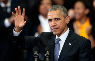 President Barack Obama waves to a group of people before he speaks at Lawson State Community College, Thursday, March 26, 2015, in Birmingham, Ala. The president talked about the progress to financial systems and economic policies. (AP Photo/Butch Dill)