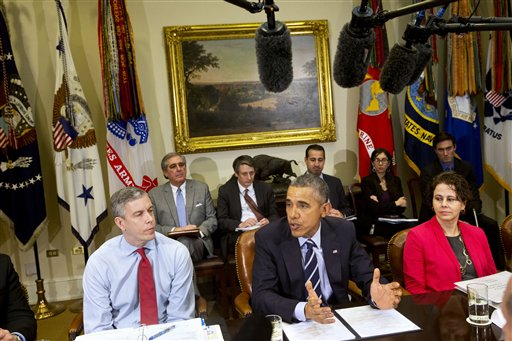 President Barack Obama, flanked by Education Secretary Arne Duncan, left, and Cecilia Muñoz, Director of the White House Domestic Policy Council, meets with the Council of the Great City Schools Leadership, Monday, March 16, 2015, in the Roosevelt Room of the White House in Washington. (AP Photo/Jacquelyn Martin)