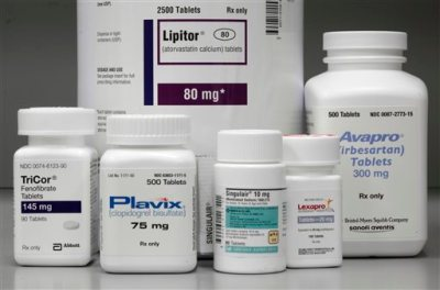 In this June 14, 2011, file photo, bottles of prescription drugs: Lipitor, TriCor, Plavix, Singulair, Lexapro and Avapro are displayed at Medco Health Solutions Inc., in Willingboro, N.J. Express Scripts Holding Co. said Tuesday, March 10, 2015, that prescription drugs spending rose 13 percent last year, the largest annual increase since 2003. (AP Photo/Matt Rourke, File)