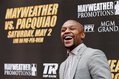 Boxer Floyd Mayweather Jr. arrives for a news conference, Wednesday, March 11, 2015, in Los Angeles. Mayweather is scheduled to fight Manny Pacquiao, of the Philippines, in Las Vegas on May 2. (AP Photo/Jae C. Hong)