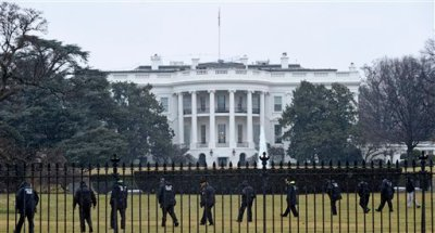 In this Jan. 26, 2015 file photo, Secret Service officers search the south grounds of the White House in Washington after an unmanned aerial drone was found on the White House grounds during the middle of the night. Mysterious, middle-of-the-night drone flights by the U.S. Secret Service during the next several weeks over parts of Washington are part of secret government testing intended to find ways to interfere with rogue drones or knock them out of the sky. (AP Photo/Susan Walsh, File)