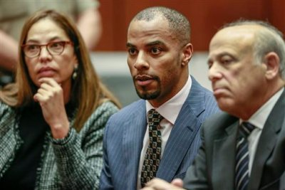 Former NFL safety Darren Sharper, center, with his attorneys, Lisa Wayne, left, and Leonard Levine, right, appear in Los Angeles Superior Court on Monday, March 23, 2015. Sharper was sentenced to nine years in federal prison Monday immediately after he pleaded guilty to sexually assaulting a woman in Arizona, marking the first change of plea of the day for the former safety accused of drugging and assaulting women in four states. (AP Photo/Nick Ut, Pool)