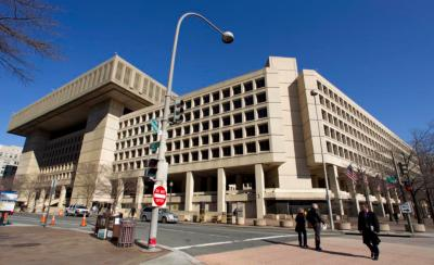 "This Feb. 3, 2012 file photo shows Federal Bureau of Investigation (FBI) headquarters in Washington. Just six blocks from the White House, the FBI's hulking headquarters overlooking Pennsylvania Avenue has long been the government building everyone loves to hate. The verdict: it's an ugly, crumbling concrete behemoth. An architectural mishap, all 2.4 million square feet of it. But in this time of tight budgets, massive deficits and the ""fiscal cliff,"" the 38-year-old FBI headquarters building has one big thing in its favor. It sits atop very valuable real estate, an entire city block on American's Main Street midway between the U.S. Capitol and the White House. Just how valuable, the General Services Administration intends to find out. (AP Photo/Manuel Balce Ceneta, File)"