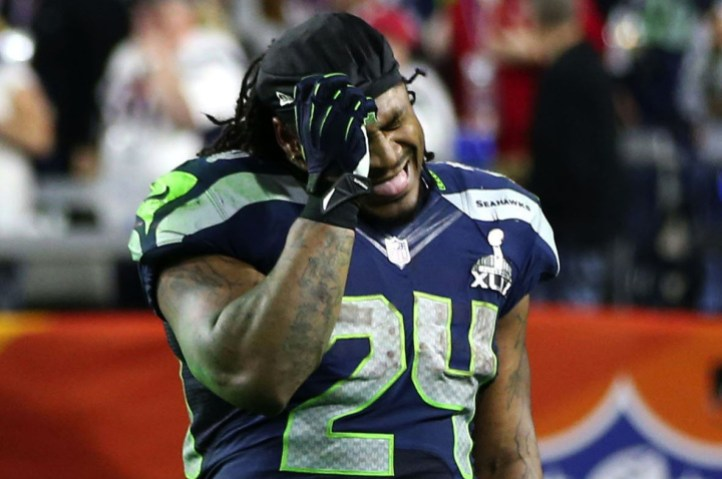 In this Sunday, Feb. 1, 2015, photo, Seattle Seahawks running back Marshawn Lynch reacts to the interception that sealed the Seahawks 28-24 loss to the New England Patriots in the NFL Super Bowl XLIX football game in Glendale, Ariz. (AP Photo/The Seattle Times, Bettina Hansen)  SEATTLE OUT; USA TODAY OUT; MAGS OUT; TELEVISION OUT; NO SALES; MANDATORY CREDIT TO BOTH THE SEATTLE TIMES AND THE PHOTOGRAPHER