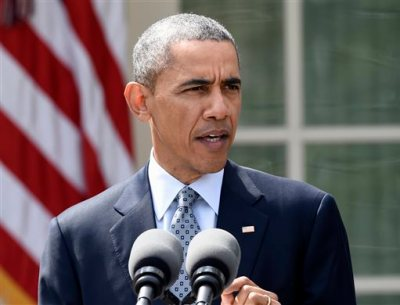 In this April 2, 2015, file photo, President Barack Obama speaks in the Rose Garden of the White House in Washington. Obama will ask Americans on Tuesday, April 7 to think of climate change as a threat not just to the environment, but also to their health. (AP Photo/Susan Walsh, File)