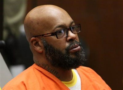 "Former rap mogul Marion ""Suge'' Knight appears in a Los Angeles court, Wednesday, April 8, 2015, on charges that he and comedian Micah ""Katt"" Williams stole a photographer's camera in Beverly Hills, Calif. During the proceeding, Knight officially fired one of his previous attorneys, David Kenner, who was not present in court. (AP Photo/Los Angeles Times, Irfan Khan, Pool)"