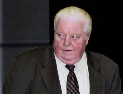 In this June 8, 2010 file photo, former Chicago Police Lt. Jon Burge arrives at the federal building in Chicago. Mayor Rahm Emanuel and several Chicago aldermen are offering what they call a reparations package for the victims of torture under the city's former police commander. The city said Tuesday, April 14, 2015, that the package will include an apology, a $5.5 million fund and city services, such as job training and tuition for victims and their families. Burge was released from a halfway house in February 2015 after serving 4 1/2 years for lying about the torture of suspects. (AP Photo/Charles Rex Arbogast, File)