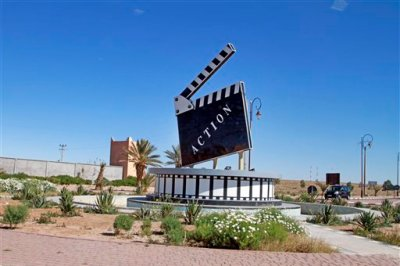 In this photo dated Jan. 29, 2015 a movie-themed municipal art on a traffic circle in the city of Ouarzazate where dozens of foreign movies are filmed every year. It has been a banner year for filming in Morocco with more money spent by foreign film productions in the country in 2014 than in the past five years put together, as it rides on its reputation for stability and exotic locales. (AP Photo/ Paul Schemm)