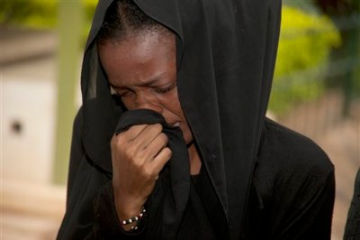 A weeping relative reacts after viewing the body of a family member killed in Thursday's attack on a university, at Chiromo funeral home, Nairobi, Kenya, Saturday, April 4, 2015. Al-Shabab gunmen rampaged through a university in northeastern Kenya at dawn Thursday, killing scores of people in the group's deadliest attack in the East African country. Four militants were slain by security forces to end the siege just after dusk. (AP Photo/Sayyid Azim)