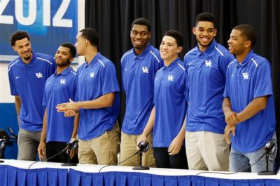 From left, Kentucky NCAA college basketball players Willie Cauley-Stein, Andrew Harrison, Trey Lyles, Dakari Johnson, Devon Booker, Karl-Anthony Towns and Aaron Harrison stand during a news conference where they announced their intent to place their names in the NBA draft at the Joe Craft Center, Thursday, April 9, 2015, in Lexington, Ky. (AP Photo/James Crisp)