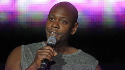 Santa Fe police say a man tossed a banana peel at Dave Chappelle during a show, hitting the comedian in the leg. Above, Chappelle performs in New Orleans in July 2014. (Gerald Herbert/AP Photo)