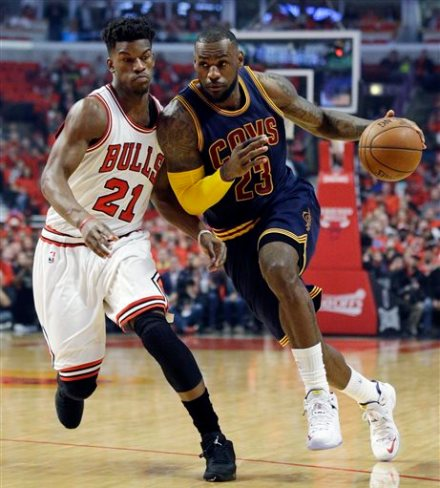 Cleveland Cavaliers forward LeBron James, right, drives past Chicago Bulls guard Jimmy Butler during the first half of Game 4 in a second-round NBA basketball playoff series in Chicago on Sunday, May 10, 2015. (AP Photo/Nam Y. Huh)