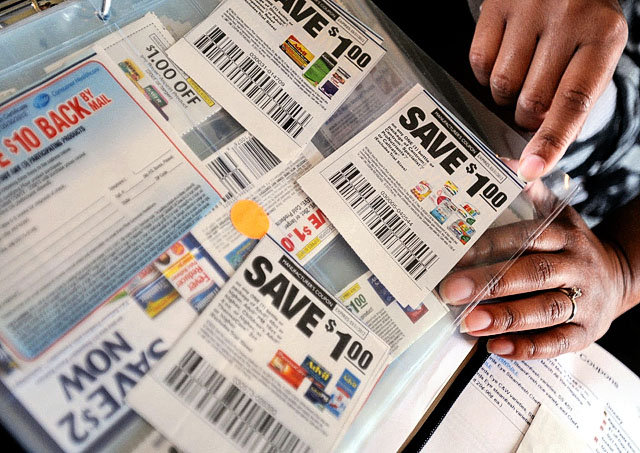 Delly Mellor, of Delly's Deals, thumbs through a binder full of coupons that she carries on her grocery shopping trips at her home in Wilmington, N.C., in this photo from April 5. Mellor operates dellysdeals.com with a coupon database and information on couponing workshops. Although you should look through the Sunday newspaper coupon inserts, most coupons can be found online. (Mike Spencer/The Star-News, via AP)