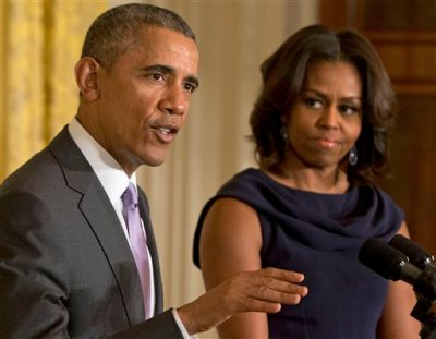 In this March 3, 2015 file photo, President Barack Obama, accompanied by first lady Michelle Obama, speaks in the East Room of the White House in Washington. The Barack Obama Foundation will hold a news conference Tuesday, May 12, 2015 in Chicago to announce where the president's library will be built — the strongest confirmation yet that the city won the sweepstakes to erect the library. (AP Photo/Jacquelyn Martin)