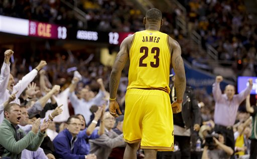 005421bbc1ae Spectators cheer Cleveland Cavaliers forward LeBron James (23) after James  scored against the Chicago
