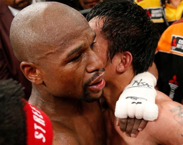Floyd Mayweather Jr., left, and Manny Pacquiao, from the Philippines, embrace in the ring at the finish of their welterweight title fight on Saturday, May 2, 2015 in Las Vegas. (AP Photo/John Locher)