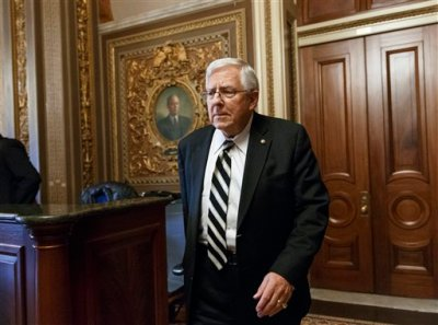 In this Jan. 14, 2014 file photo, Senate Budget Committee Chairman Sen. Mike Enzi, R-Wyo., leaves a closed-door GOP caucus luncheon on Capitol Hill in Washington. On paper and in speeches, Republicans boast that Congress' first budget since they won control of the Senate and House last fall will eliminate red ink within a decade. Actually, it will do nothing of the sort.That's because the budget itself is non-binding, and on its own, has no effect on spending. (AP Photo/J. Scott Applewhite, File )