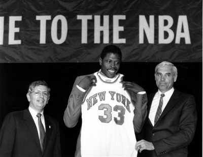 In this June 18, 1985, file photo, Patrick Ewing accepts his New York Knicks jersey from Dave DeBusschere, right, general manager of the Knicks, as NBA commissioner David Stern look on, at the NBA Draft in New York. The NBA draft lottery debuted 30 years ago. The 2015 NBA draft lottery will take place in New York on Tuesday, May 19, 2015. (AP Photo/Marty Lederhandler, File)