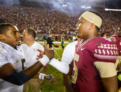 In this Oct. 18, 2014, file photo, Florida State quarterback Jameis Winston, right, greets Notre Dame quarterback Everett Golson after Florida State won 31-27 in an NCAA college football game in Tallahassee, Fla. Former Notre Dame quarterback Everett Golson says he is transferring to Florida State, where he will have the chance to replace Jameis Winston. In a statement to Fox Sports, Golson said Tuesday, May 19, 2015, after much consideration he will spend his fifth year of eligibility with the Seminoles. (AP Photo/Mark Wallheiser, File)