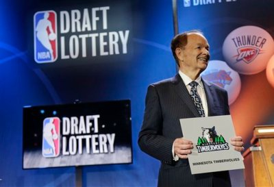 Minnesota Timberwolves owner Glen Miller poses for photos after the Timberwolves won the No. 1 pick in the NBA basketball draft lottery Tuesday, May 19, 2015, in New York. (AP Photo/Julie Jacobson)
