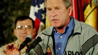 US President George W. Bush speaks to US troops at the Baghdad International Airport on Thursday, November 27, 2003, in Baghdad, Iraq. (AP Photo/Pablo Martinez Monsivais)