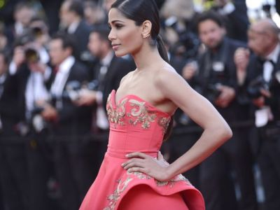 "Freida Pinto arrives Sunday for the screening of ""The Homesman"" at the 67th international film festival, Cannes in France. (AP Photo)"