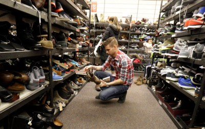 In this Dec. 26, 2014, file photo, customers shop at Nordstrom Rack in Schaumburg, Ill. Big discounts, and crowds, are expected for the post-Christmas sales. The Commerce Department releases retail sales data for December on Wednesday, Jan. 14, 2015. (AP Photo/Nam Y. Huh, File)