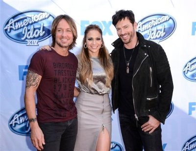 """In a Tuesday, Dec. 9, 2014 file photo, from left to right, singer Keith Urban, singer and actress Jennifer Lopez, and singer Harry Connick, Jr. arrive on set of """"American Idol"""" in Los Angeles. Fox announced announced Monday, May 11, 2015 that """"American Idol"""" will go off the air after its 15th and final season next spring. (Photo by Dan Steinberg/Invision/AP, File)"""