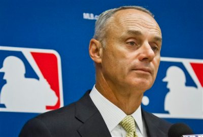 Baseball commissioner Rob Manfred listens during a press conference after his first owners' meeting as baseball commissioner, Thursday, May 21, 2015, in New York. (AP Photo/Bebeto Matthews)