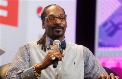 """In this March 20, 2015 file photo, rapper Snoop Dogg takes part in the """"Keynote Conversation with Snoop Dogg"""" at the South by Southwest festival in Austin, Texas. Texas' chief law enforcement official called Snoop Dogg a """"dope smoking cop hater"""" before reprimanding a state trooper who posed for a picture with the rapper, according to emails made public Wednesday, May 6, 2015. (Jack Plunkett/Invision via AP, File)"""