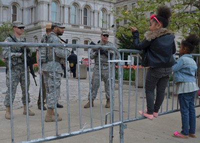 Two young girls talk to national guardsmen outside of city hall in Baltimore, Md., on Friday, May 1. (Freddie Allen/NNPA News Wire Service)