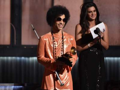 "In this Feb. 8, 2015 file photo, Prince presents the award for album of the year at the 57th annual Grammy Awards in Los Angeles. Prince has announced plans to perform at a concert in Baltimore following recent unrest in the city over the death of a man who was fatally injured in police custody. A statement issued Tuesday, May 5, 2015, says the pop icon will perform Sunday, May 10, at ""Rally 4 Peace,"" a concert at the Royal Farms Arena in Baltimore. (Photo by John Shearer/Invision/AP)"