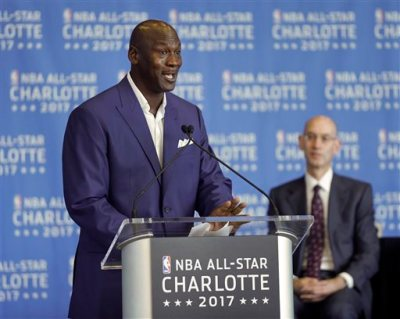 Charlotte Hornets owner Michael Jordan, left, speaks as NBA Commissioner Adam Silver, right, listens during a news conference, Tuesday, June 23, 2015, to announce Charlotte, N.C., as the site of the 2017 NBA All-Star basketball game. (AP Photo/Chuck Burton)