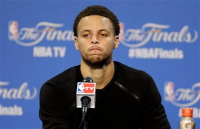 Golden State Warriors guard Stephen Curry (30) listens to question during a press conference following Game 3 of basketball's NBA Finals against the Cleveland Cavaliers in Cleveland, Wednesday, June 10, 2015. The Cavaliers defeated the Warriors 96-91. (AP Photo/Tony Dejak)