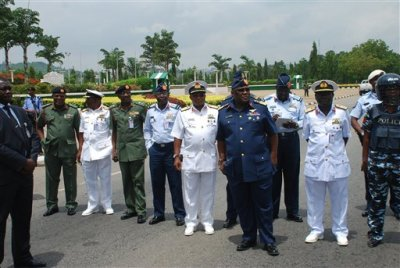 In this Monday, May. 26, 2014 file photo, Nigeria's chief of defense staff Air Marshal Alex S. Badeh, foreground third right, and other military chiefs wait to address the Nigerians Against Terrorism group during a demonstration calling on the government to rescue the kidnapped girls of the government secondary school Chibok, in Abuja, Nigeria. Nigerian military abuses caused the deaths of some 8,000 people in the fight against Boko Haram extremists, Amnesty International said Wednesday, June. 3, 2015  in a report naming senior officers it wants investigated for alleged war crimes. (AP Photo/Olamikan Gbemiga File)