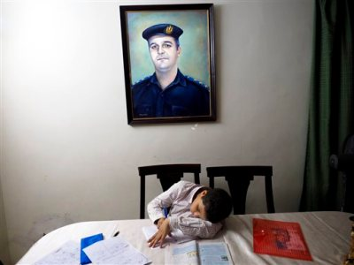 "In this picture taken on Oct. 17, 2014, 13-year-old Adham Ehab Anwar, whose policeman father was shot to death in an attack on his station after the bloody security force breakup of Islamist sit-ins in Cairo in 2013, studies geometry at his home in 6 October city, a suburb southwest of Cairo, in Giza, Egypt. Psychiatrist Eman Gaber, who leads a rehabilitation program for traumatized children, says there are not any statistics about how many children suffered trauma in Egypt's recent unrest, though it's ""still hard not to be exposed to any violence,"" whether that was rioting in their neighborhood or images seen on television or the Internet."" (AP Photo/Hamada Elrasam)"