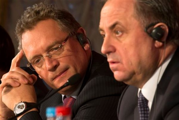 FIFA Secretary General Jerome Valcke, left, and Russian Sports Minister Vitaly Mutko attend a press conference in St.Petersburg, Russia, Monday, Feb. 16, 2015. The 2018 FIFA World Cup Russia Local Organising Committee (Russia 2018 LOC) is holding its 5th Management Board meeting with FIFA participation in St.Petersburg. The Board's role is to jointly govern the preparations for FIFA World Cup 2018. (AP Photo/Dmitry Lovetsky)