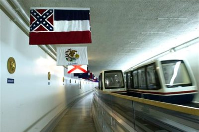 The Mississippi flag hangs, with the other state flags, in the subway between the U.S. Capitol and Dirksen Senate Office Building in Washington, Tuesday, June 23, 2015.  In the wake of a massacre at a black church in Charleston, S.C., a bipartisan mix of officials across the country is calling for the removal of Confederate flags and other symbols of the Confederacy. Leaders of the Republican-controlled state of Mississippi are divided on whether to alter the state's flag, a corner of which is made up of the Confederate battle flag.  (AP Photo/Cliff Owen)