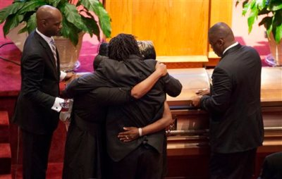 Family members embrace as the casket for Ethel Lance is closed during her funeral service at Emanuel AME Church, Thursday, June 25, 2015, in North Charleston, S.C.  Lance was one of the nine people killed in the shooting at Emanuel AME Church last week in Charleston. (AP Photo/David Goldman)