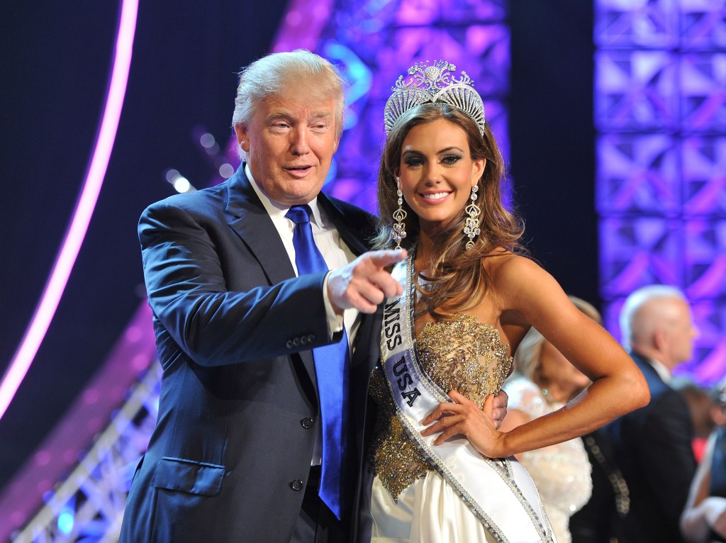 """FILE - In this June 16, 2013 file photo, Donald Trump, left, and Miss Connecticut USA Erin Brady pose onstage after Brady won the 2013 Miss USA pageant in Las Vegas, Nev. Univision says it is dropping the Miss USA Pageant and says it will cut all business ties with Donald Trump over comments he made about Mexican immigrants. The network said Thursday, June 25, 2015, it will not air the pageant on July 12, as previously scheduled, and has ended its business relationship with the Miss Universe Organization due to what it called """"insulting remarks about Mexican immigrants"""" by Trump, a part owner. (AP Photo/Jeff Bottari, File)"""