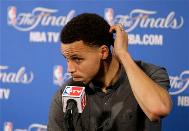 Golden State Warriors guard Stephen Curry takes questions during a news conference after Game 2 of basketball's NBA Finals Sunday, June 7, 2015, in Oakland, Calif. Cleveland won the game 95-93 in overtime. (AP Photo/Ben Margot)