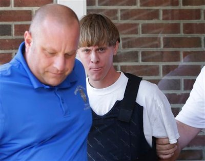 Charleston, S.C., shooting suspect Dylann Storm Roof, center, is escorted from the Sheby Police Department in Shelby, N.C., Thursday, June 18, 2015. Roof is a suspect in the shooting of several people Wednesday night at the historic The Emanuel African Methodist Episcopal Church in Charleston, S.C. The current brick Gothic revival edifice, completed in 1891 to replace an earlier building heavily damaged in an earthquake, was a mandatory stop for the likes of Booker T. Washington and the Rev. Martin Luther King Jr. Still, Emanuel was not just a church for the black community. (AP Photo/Chuck Burton)