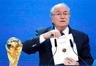 In this Thursday, Dec. 2, 2010 file photo, FIFA President Sepp Blatter announces Russia to host the 2018 World Cup during the announcement of the host country for the 2018 soccer World Cup in Zurich, Switzerland. FIFA has been plunged into crisis since seven officials were arrested in dawn raids last week at a luxury Zurich hotel and in a separate probe, Swiss authorities are investigating the 2018 and 2022 World Cup bidding contests, which went to Russia and Qatar. (AP Photo/Michael Probst, File)