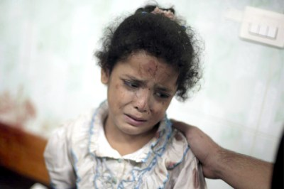 A Palestinian girl cries while receiving treatment for her injuries caused by a 2014 Israeli strike at a U.N. school in Jebaliya refugee camp, at the Kamal Adwan hospital in Beit Lahiya, northern Gaza Strip (AP Photo/Khalil Hamra)