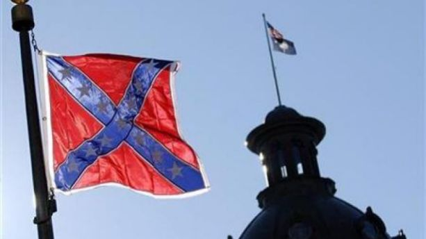 A Confederate flag flies atop the north end of the South Carolina Statehouse in Columbia (AP Photo)