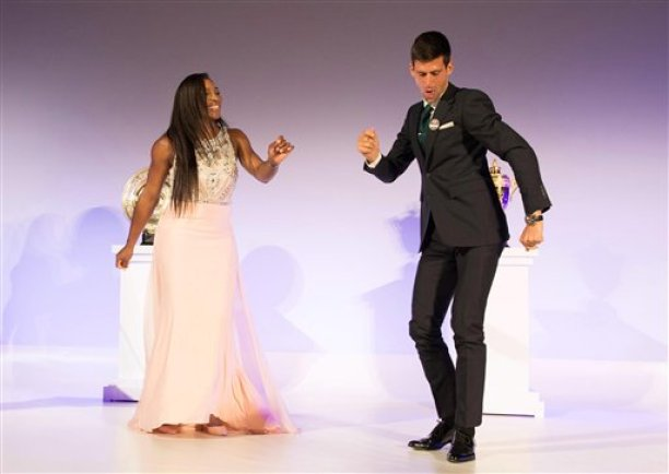 Wimbledon Champions  Novak Djokovic of Serbia, right, and Serena Williams of the US, dance on stage at the Wimbledon Champion dinner, at the Guildhall, London, Sunday, July 12, 2015. (Thomas Lovelock, Pool Photo via AP)