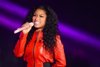 "In this June 7, 2015 file photo, Nicki Minaj performs at the 2015 Hot 97 Summer Jam at MetLife Stadium, in East Rutherford, New Jersey. Taylor Swift and Minaj traded words on Twitter after the rapper said she was upset she didn't earn a nomination for video of the year at the MTV Video Music Awards. Minaj tweeted multiple times that she didn't understand why her rump-shaking video for ""Anaconda"" wasn't up for the top award when MTV announced the nominees Tuesday, July 21, 2015. (Photo by Scott Roth/Invision/AP, File)"