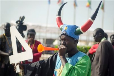 A South Sudanese man blows a horn as he attends an independence day ceremony in the capital Juba, South Sudan, Thursday, July 9, 2015. South Sudan marked four years of independence from Sudan on Thursday, but the celebrations were tempered by concerns about ongoing violence and the threat of famine. (AP Photo/Jason Patinkin)
